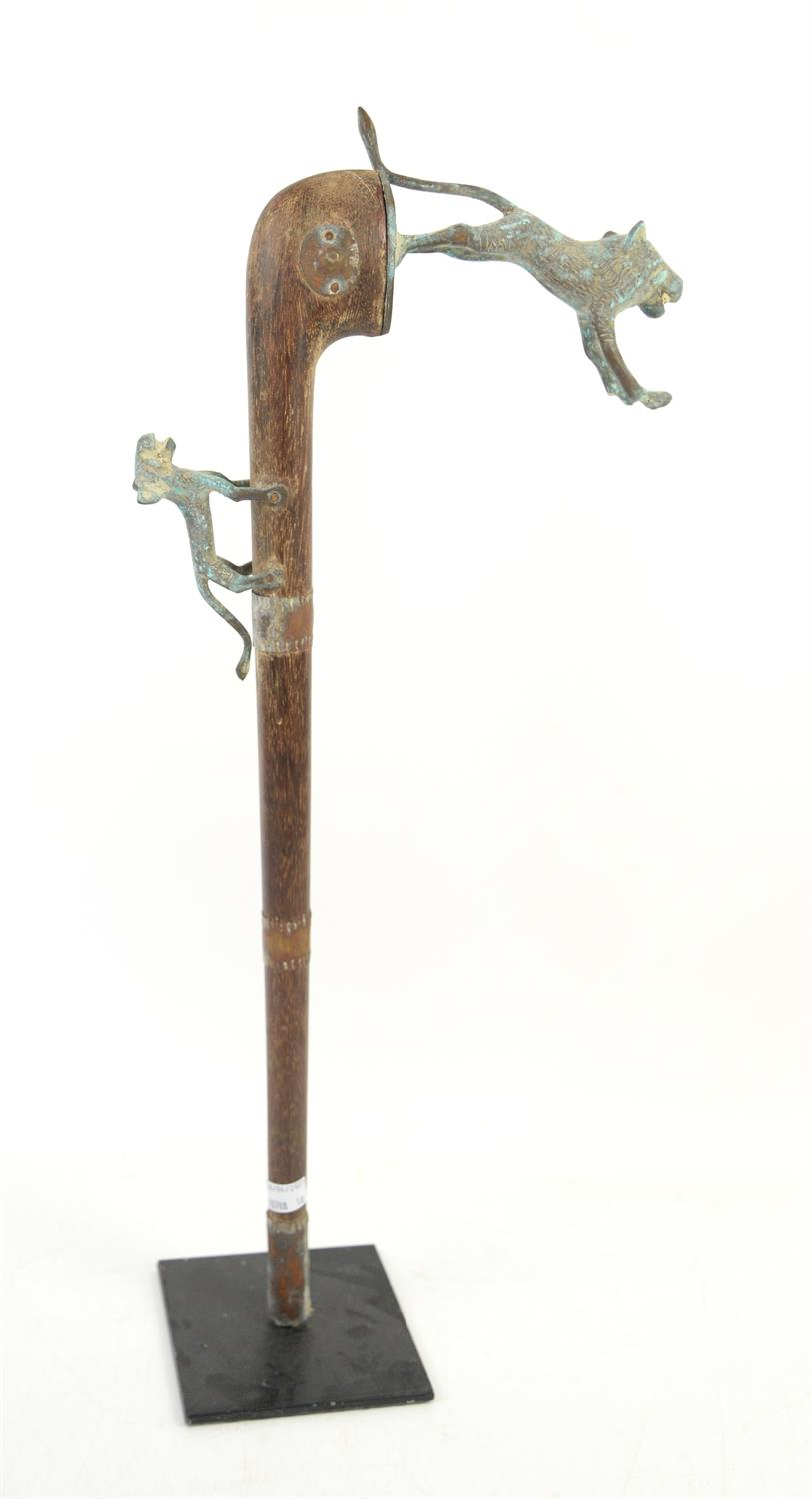 African tribal sceptre, wooden shaft with metal mounted wild dogs and metal strips, on stand, H61cm