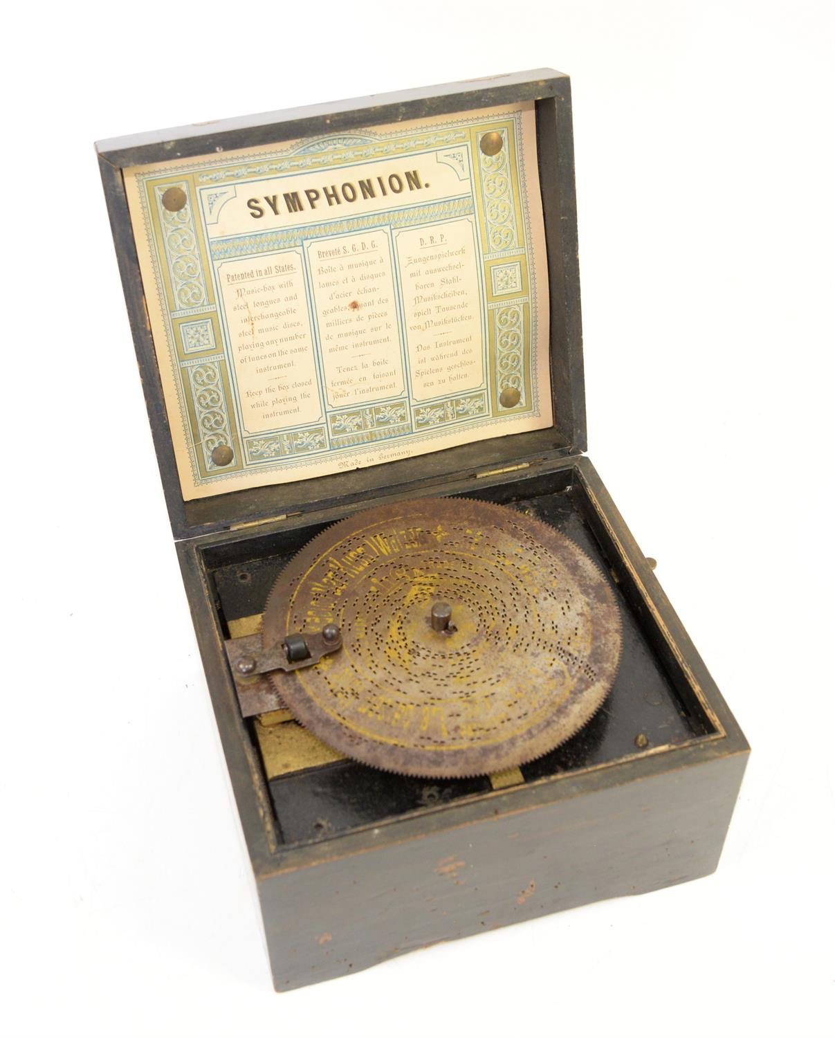 Late 19th century German Symphonion, with a single disc 14.5 cms, the box, 19.5 x 17 cms,