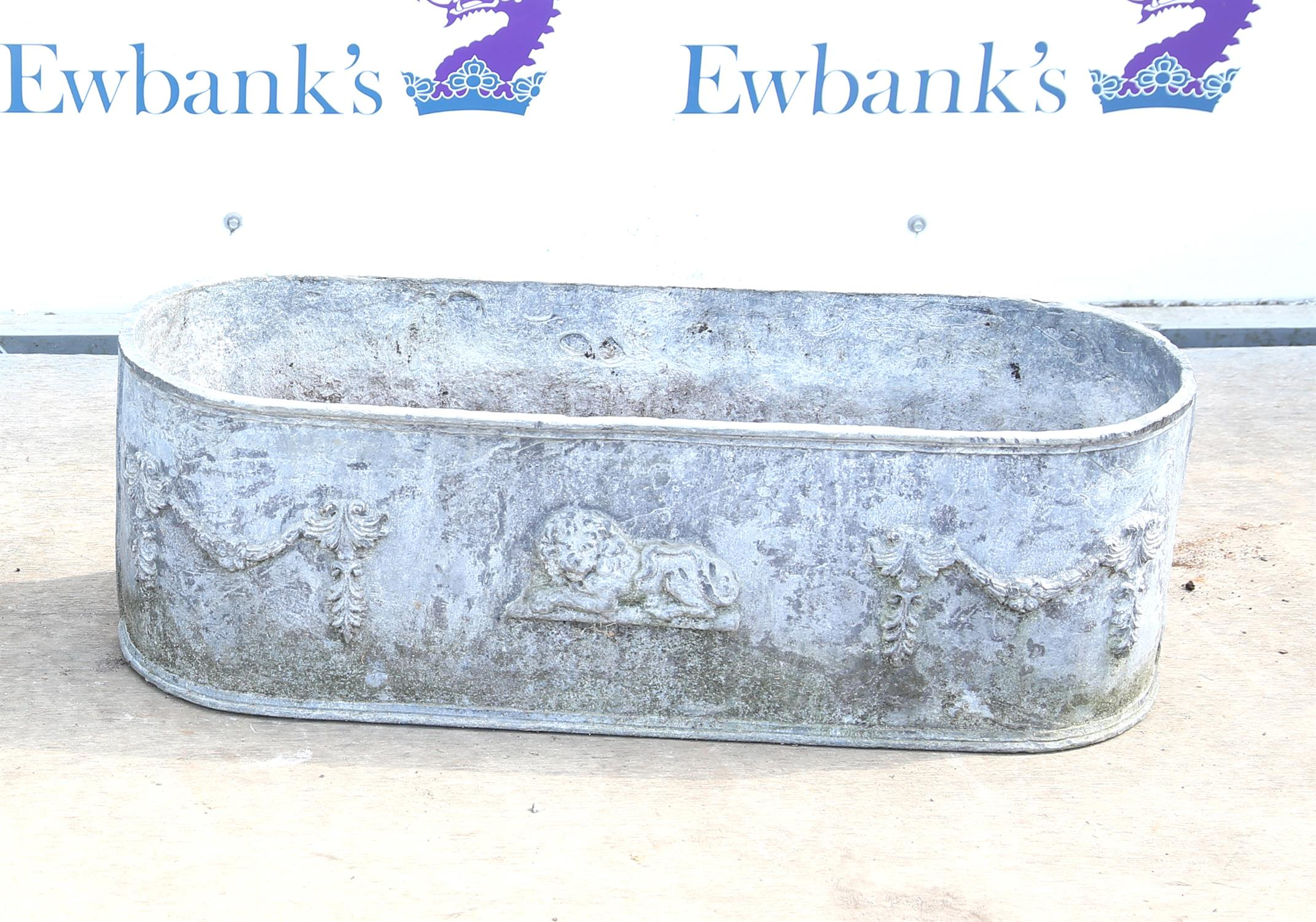 REVISED PHOTO - 20th century lead planter with moulded ends and lion and swag decoration, H25.