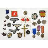 Collection of various Third Reich badges, medals, and patches to include re-strikes and