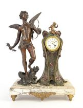 Art Noveau mantle clock mounted with a figure of Cupid on a marble base, the two train movement