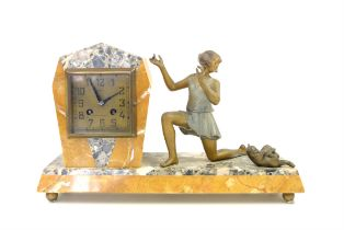 Art Deco clock inscribed Bonis Douarnenez, with figure of a girl kneeling, watching a cat playing,