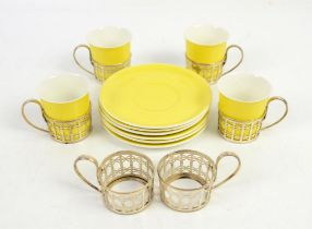 Four Shelley China yellow coffee cups and six saucers and six silver cup holders,