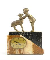Art Deco clock mounted with figure of a child embracing a fawn, gilt dial, on black and mottled