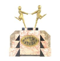 Art Deco clock mounted with a pair of gilt female figures holding a hoop, on stepped pink with