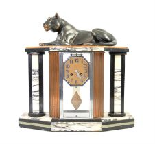 Art Deco marble mantel clock, with spelter lioness above octagonal dial with Arabic numerals,