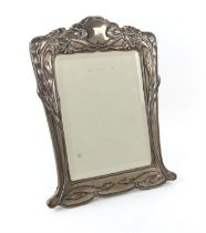 An Art Nouveau silver dressing table mirror by E Mander & Son, Birmingham 1902 with bevelled mirror