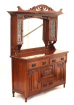Art Nouveau walnut mirrored back sideboard, the superstructure with two leaded glass cupboard doors