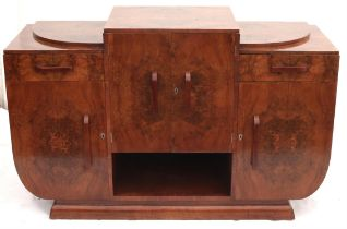 Art Decco burr walnut veneered side board, the central cupboard enclosing three drawers over a