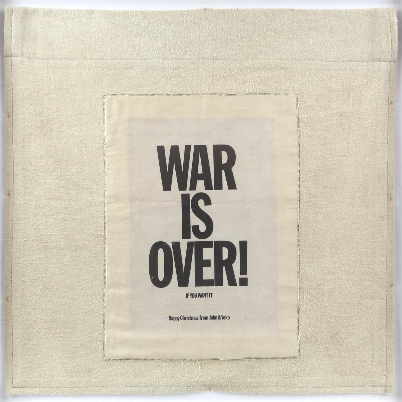 John Lennon & Yoko Ono. 'War is Over' cloth banner. Size overall 46 x 46cm. Framed and glazed.