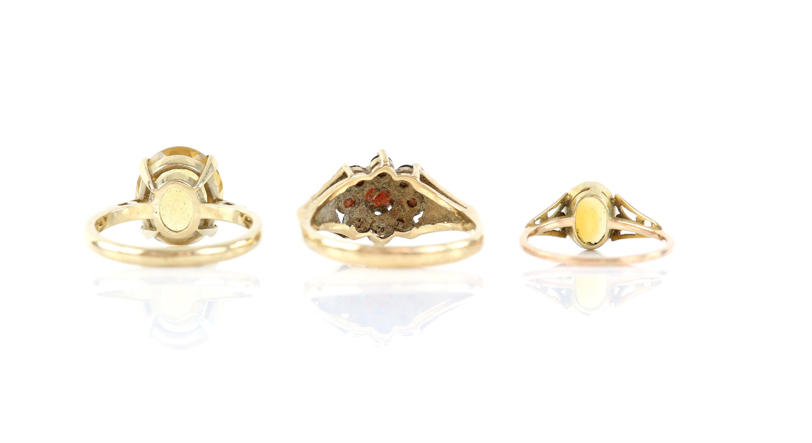 Three gem set rings, including a garnet cluster ring, size P 1/2, and two single stone citrine - Image 2 of 2