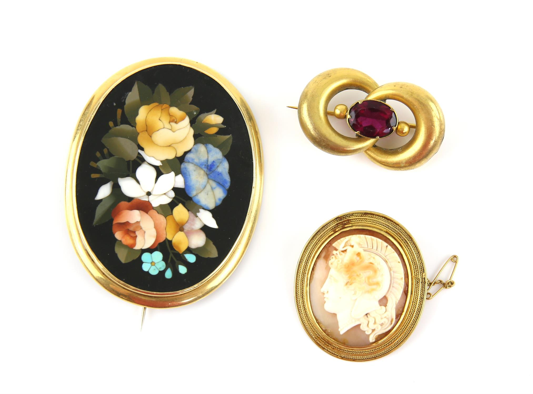 Pietra Dura floral brooch, featuring a floral motif including a forget-me-not, in a gold mount,
