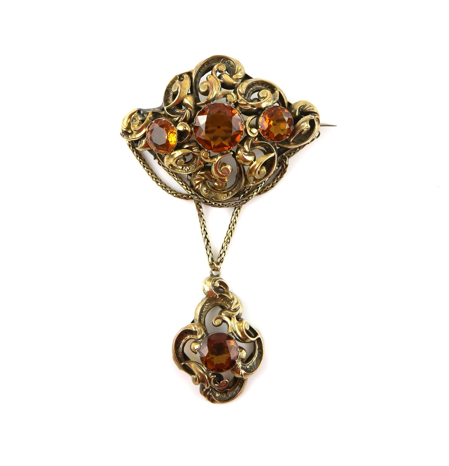 Victorian citrine drop brooch, designed as an ornate openwork brooch, set with three round cut