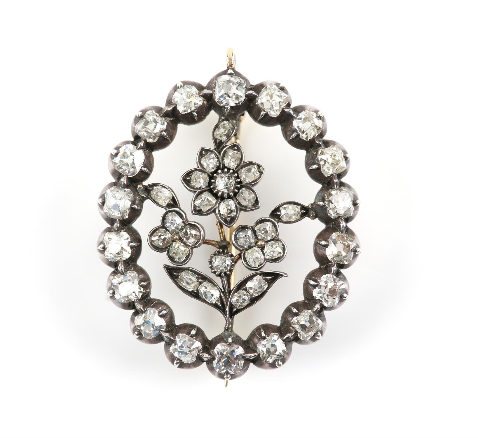 19th C floral diamond brooch, surround set with eighteen old Peruzzi cut diamonds brooch and twenty