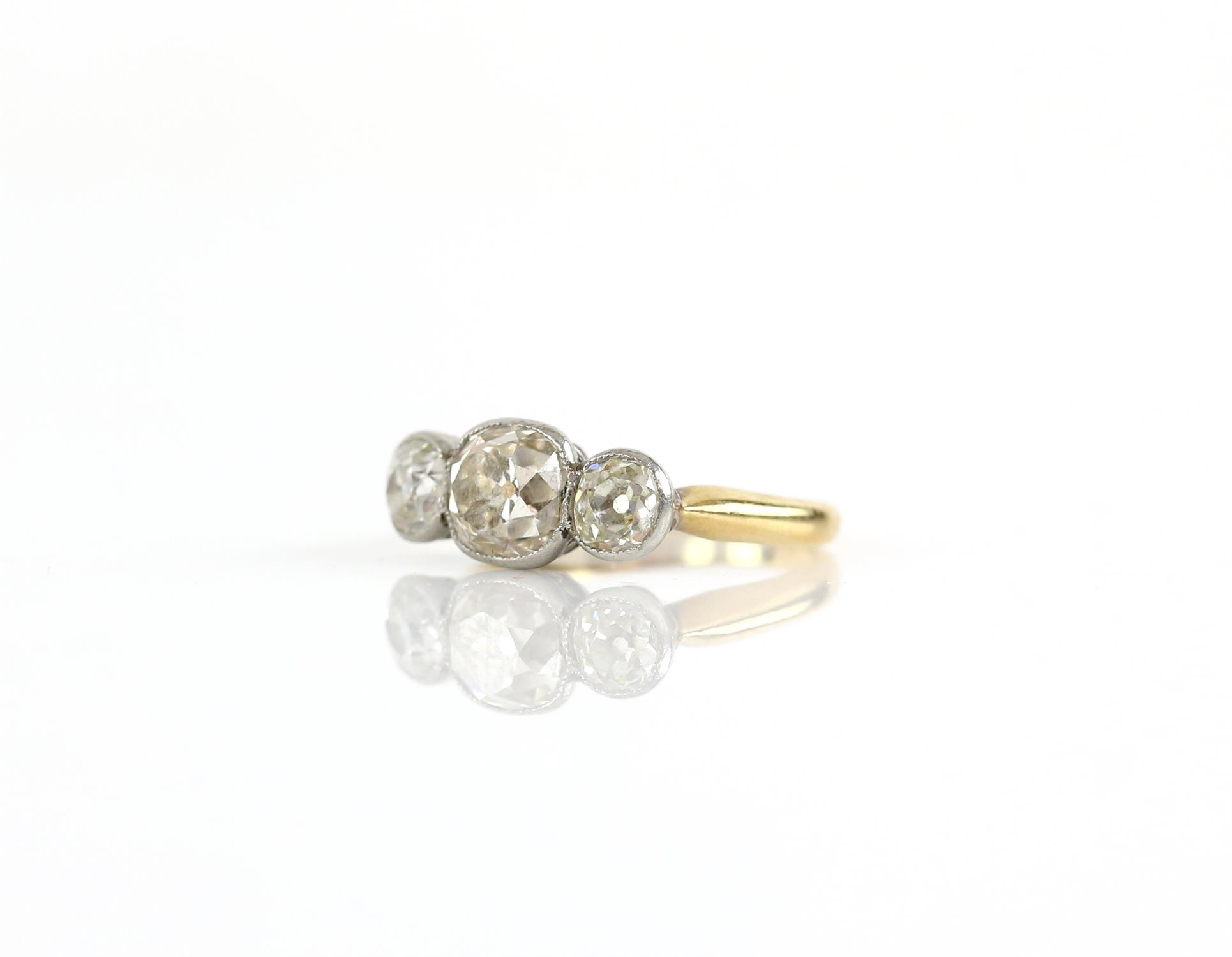 Old mine cut diamond ring, central stone estimated weight 1.20 carats, the side stone have an