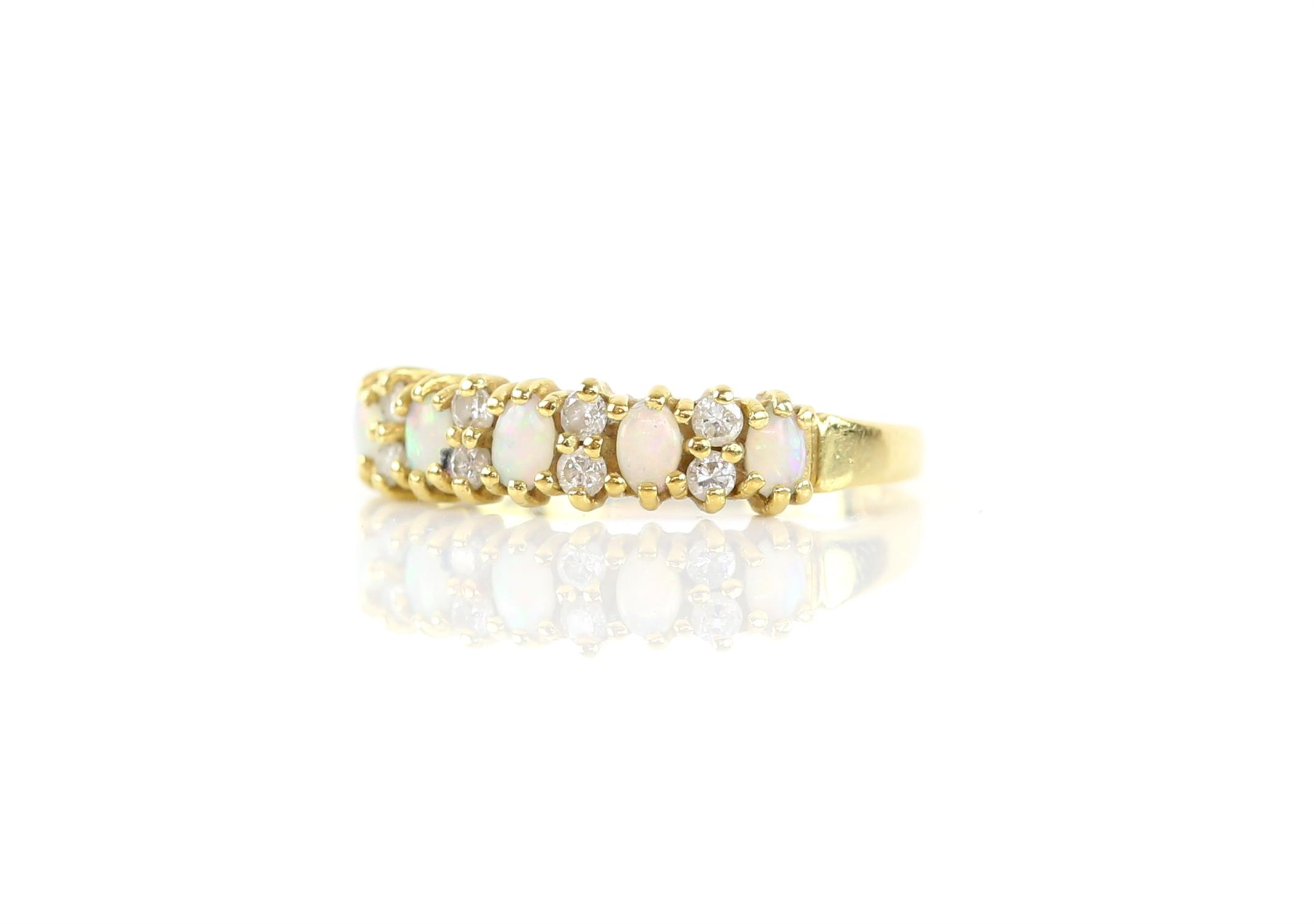 Opal and diamond half hoop ring, set with five oval cabochon cut opals, spaced with round brilliant - Image 2 of 3