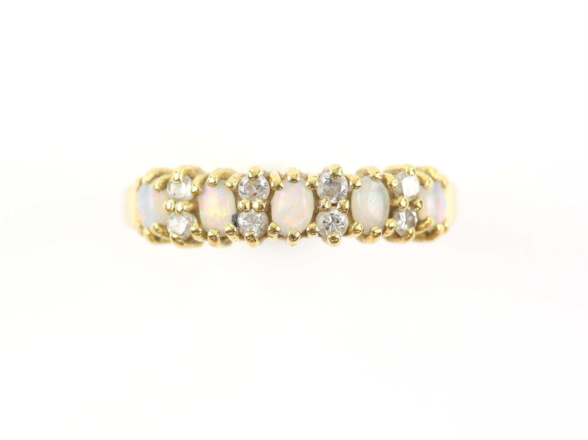 Opal and diamond half hoop ring, set with five oval cabochon cut opals, spaced with round brilliant