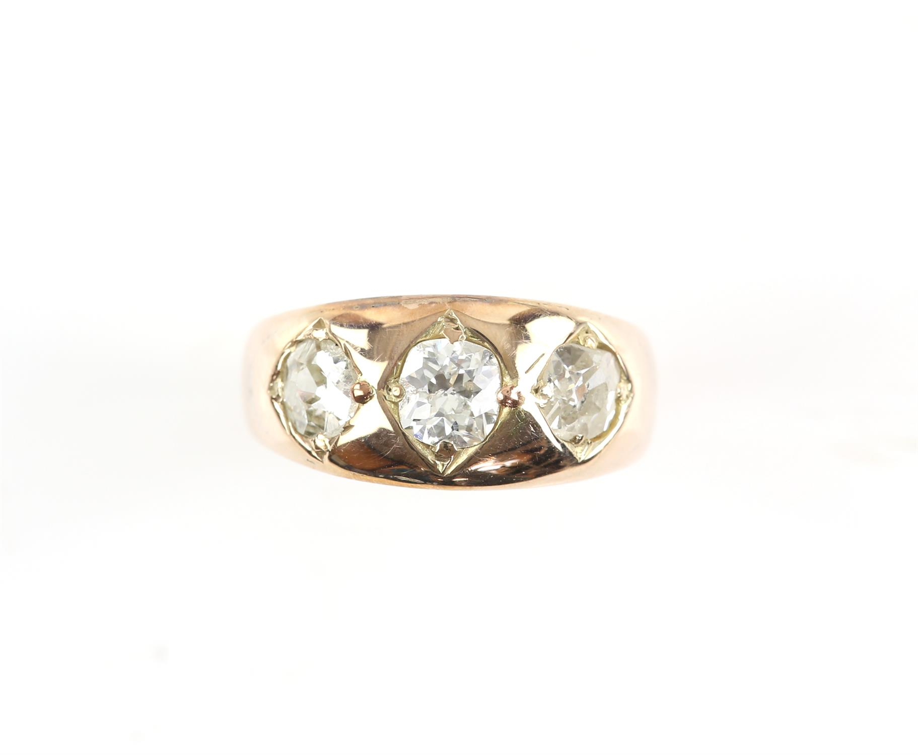 Victorian gypsy ring with three old mine cut diamonds, central diamond is 0.52 carat and the side