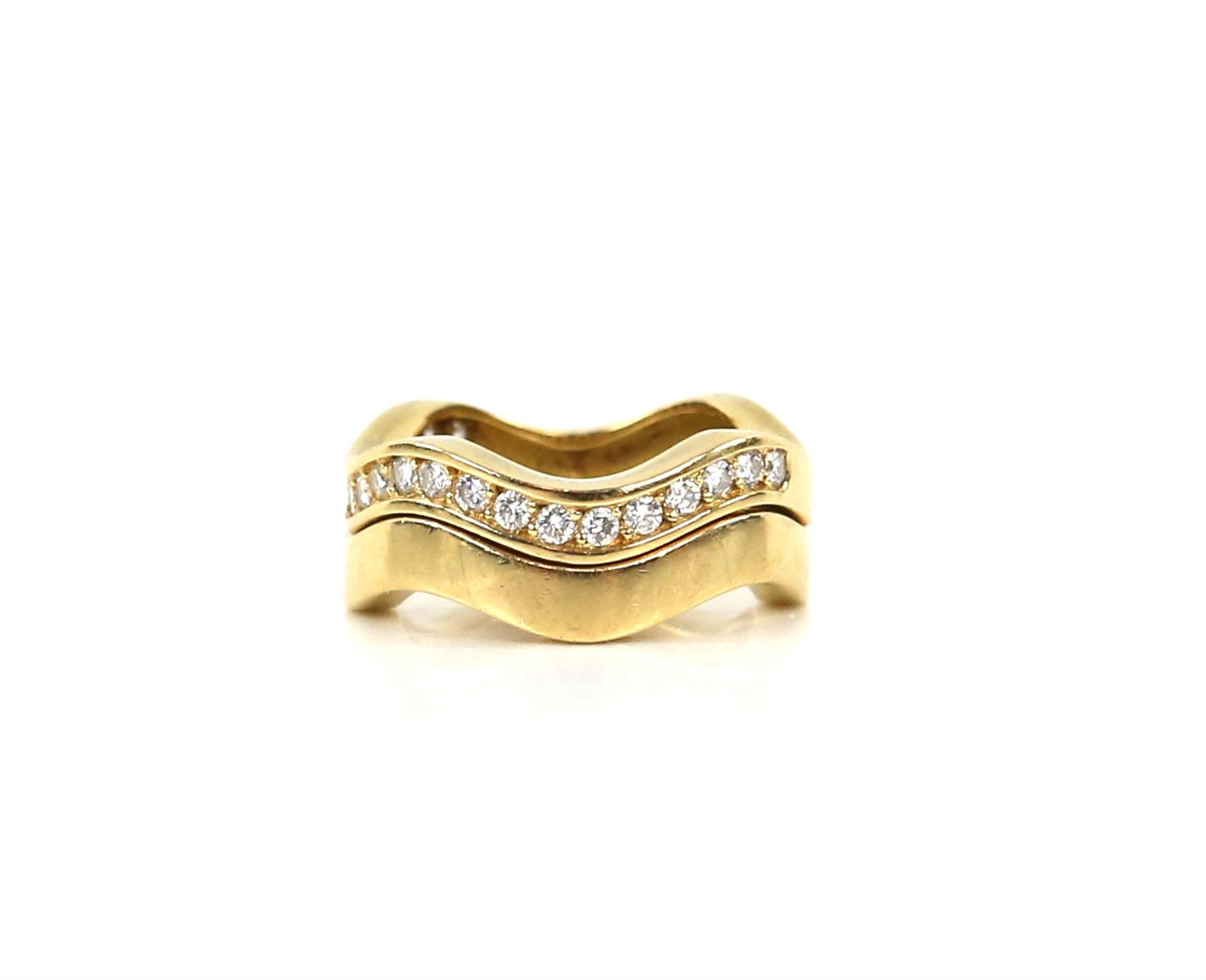 Two Cartier ring stacking wave rings, one diamond set with round brilliant cut diamonds,