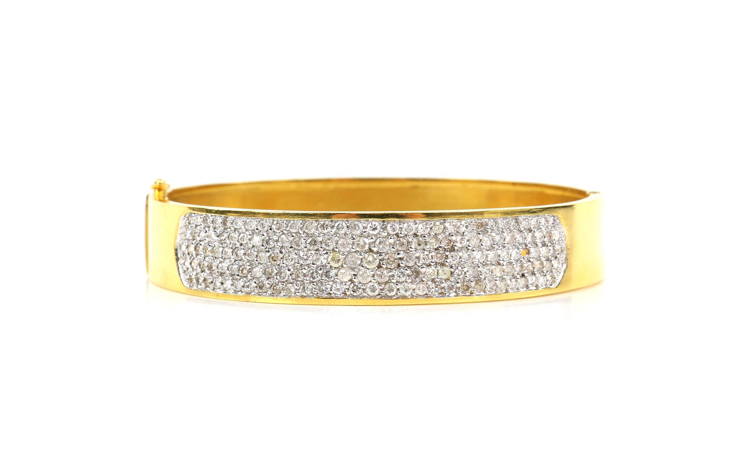 Modern diamond pave set oval hinged bangle, set with round brilliant cut diamonds,