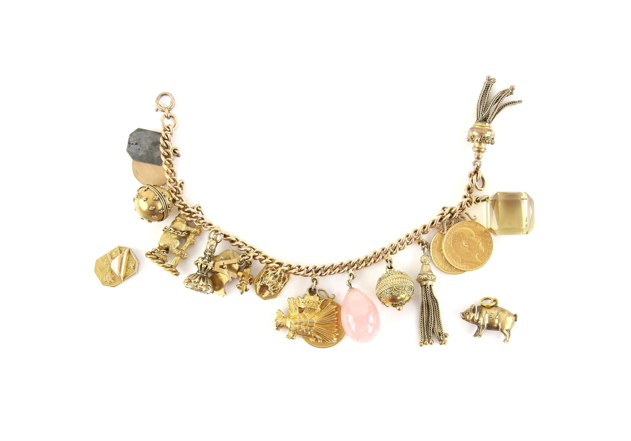 Antique charm bracelet, curb link bracelet with a bolt ring clasp,19 cm in length, hallmarked 15 ct.