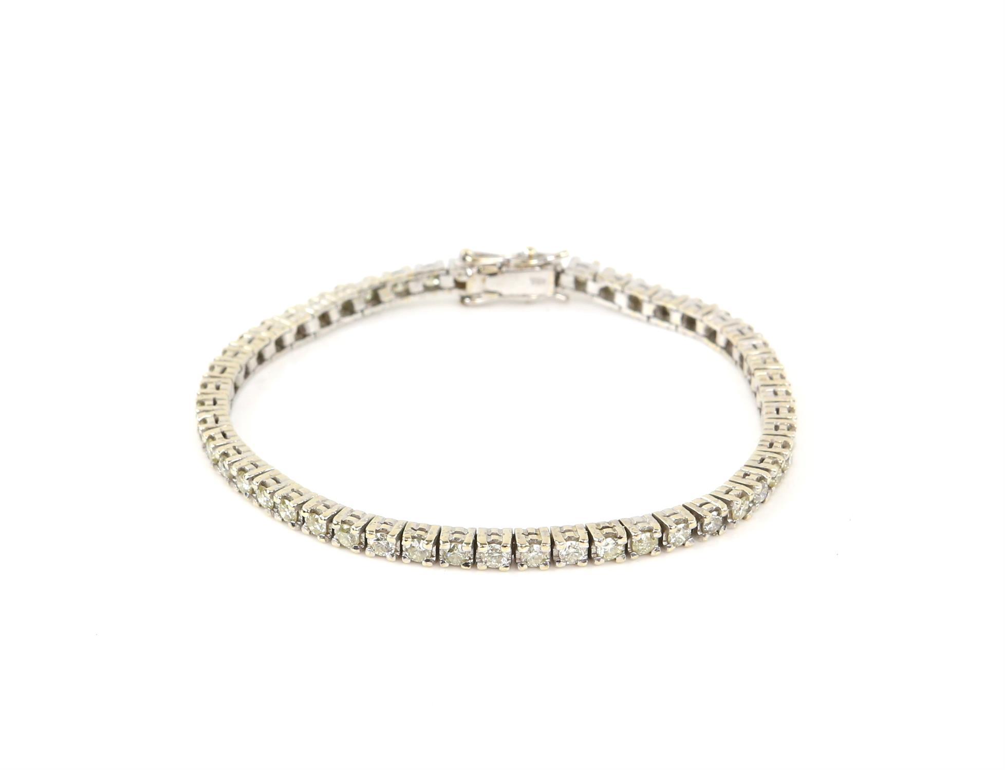Diamond line bracelet, set with round brilliant cut diamonds, estimated total diamond weight 3.