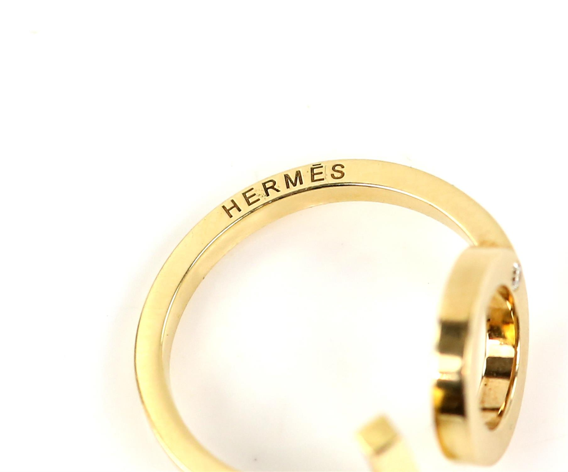 Hermes diamond ring, set with two round brilliant cut diamonds, torque style ring with one circular - Image 4 of 6
