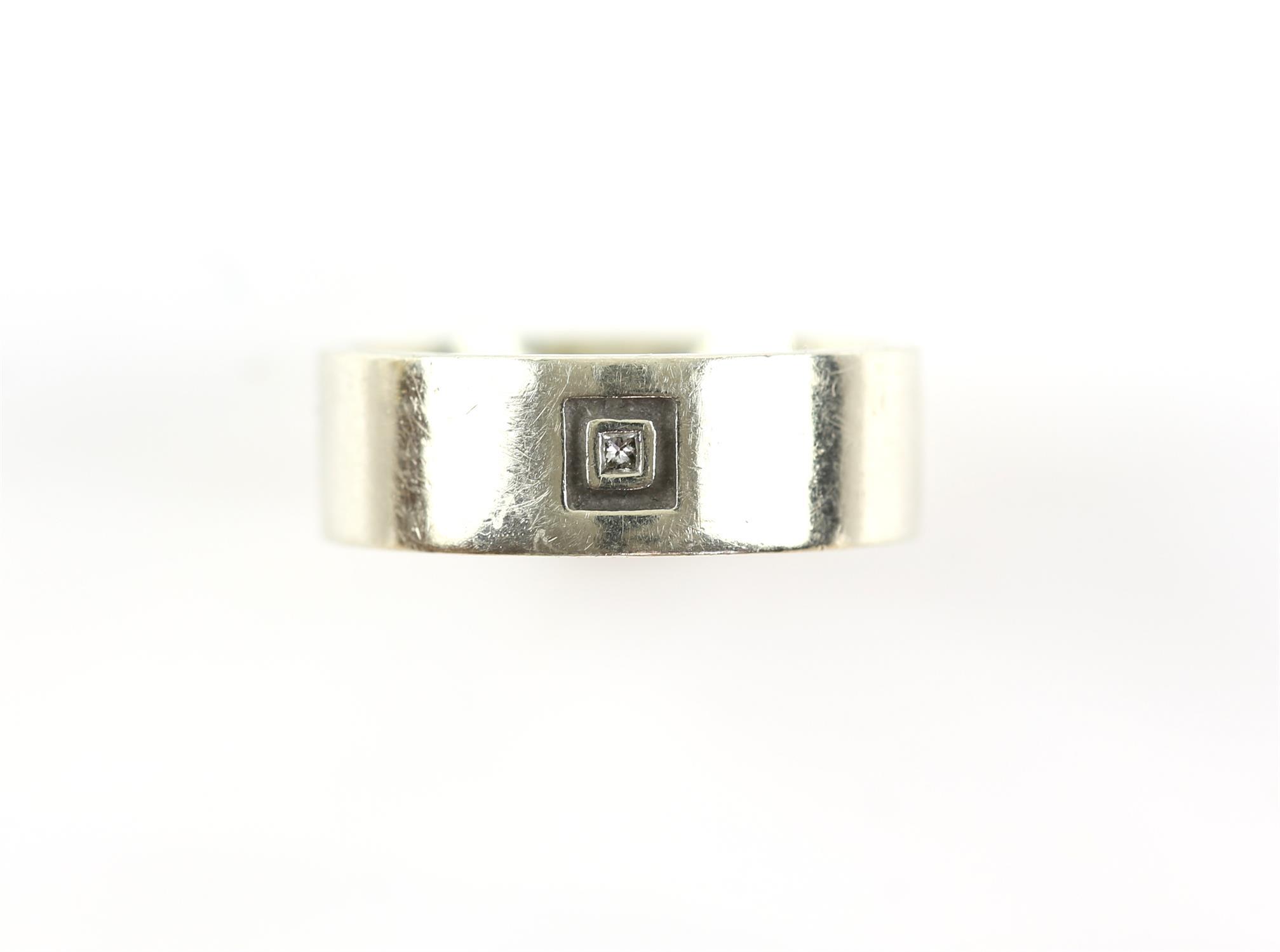 Single stone diamond wedding band, 7.25mm band, hallmarked 9 ct, London, with makers mark RJ,