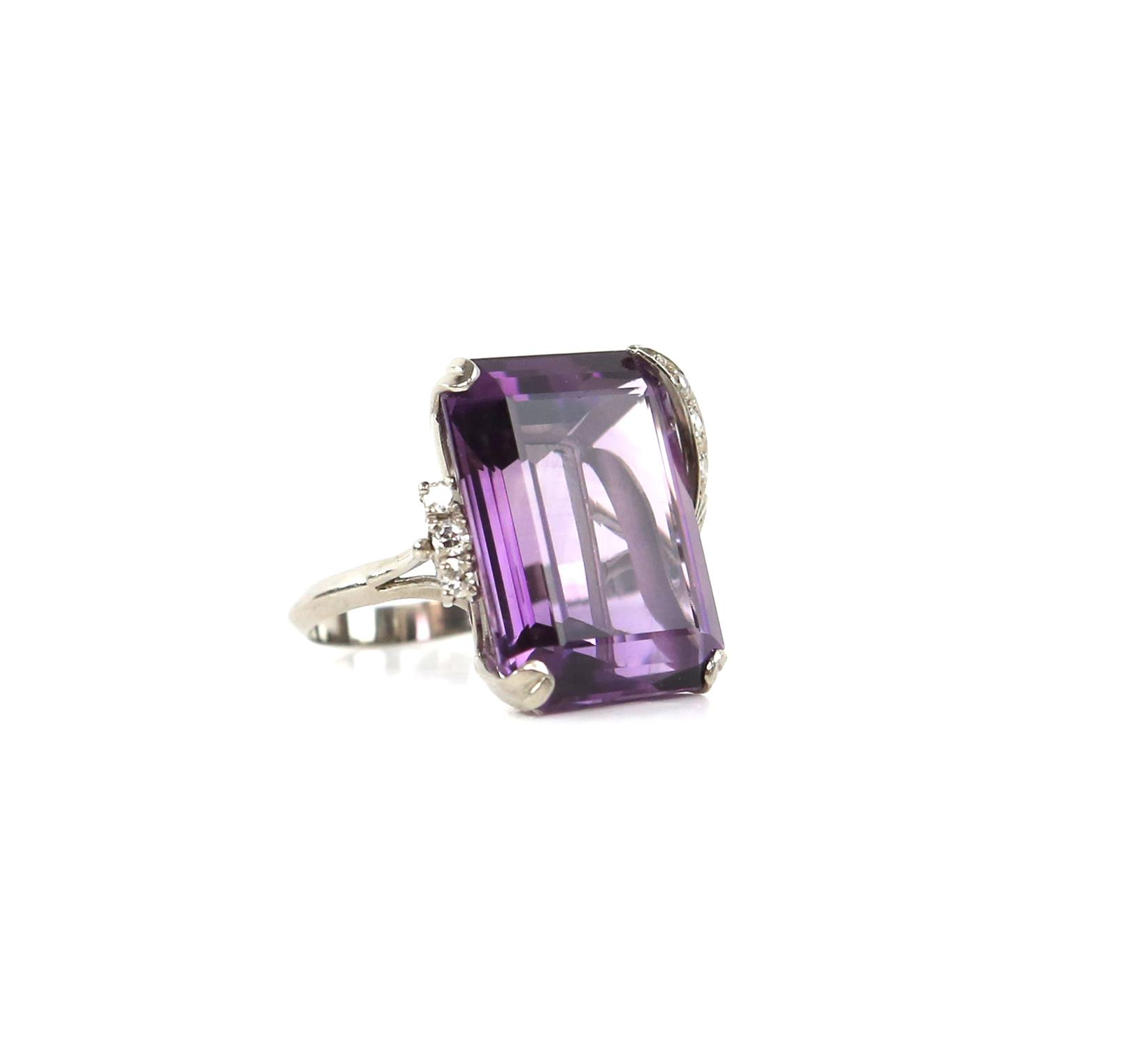 Amethyst and diamond cocktail ring, central rectangular cut amethyst, estimate weight 22.78 carats,