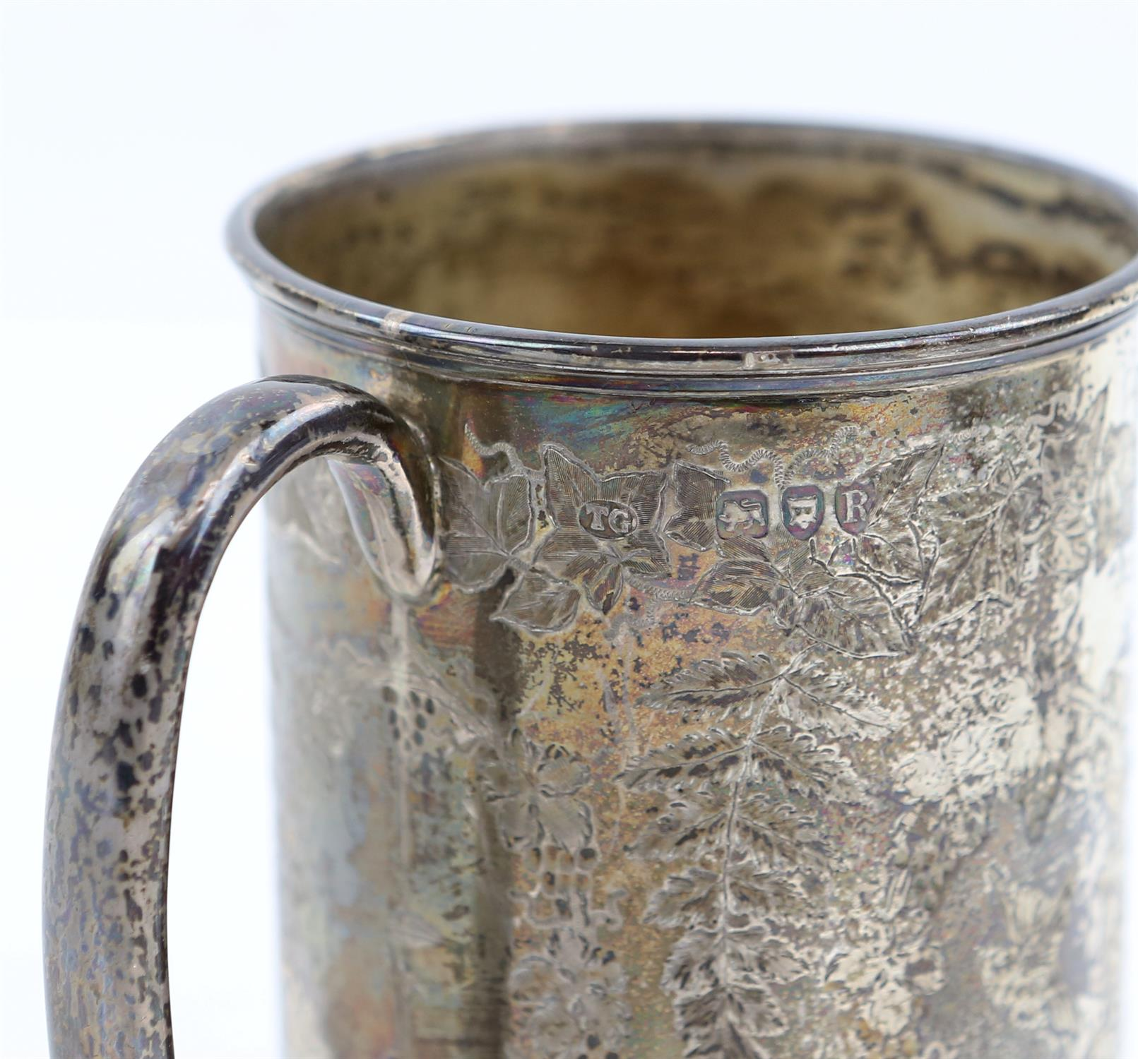 Victorian fern engraved silver mug, a silver sauce boat, a silver small trophy cup 403 grms 13 ozs - Image 8 of 10