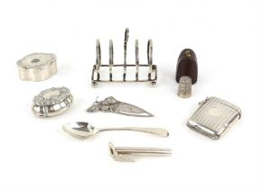 Engine turned silver vesta case, two pin boxes, small toast rack, posy holder, book mark and tea