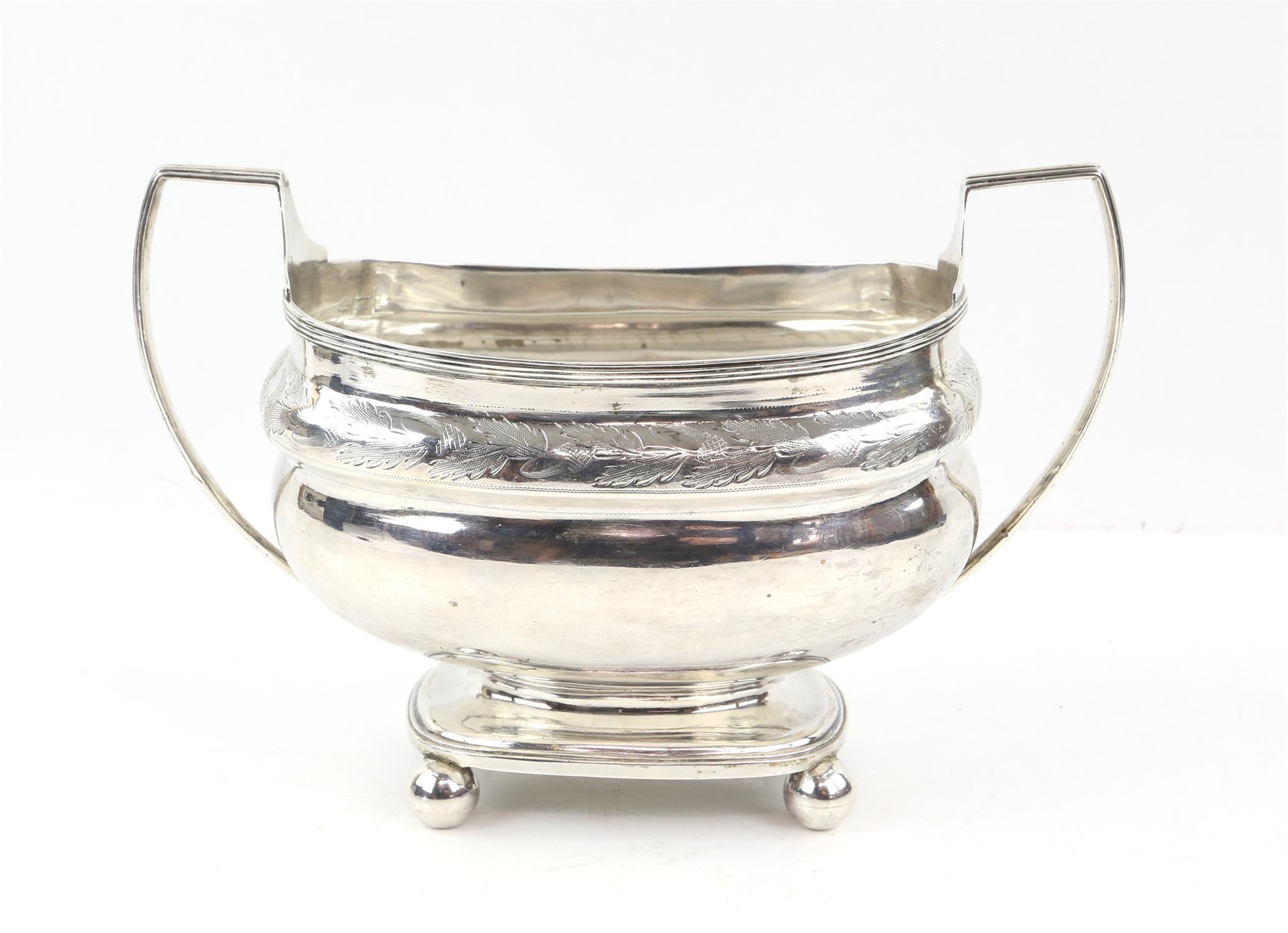 George III two handled sugar bowl with oak leaf band on ball feet, by Ann Robertson Newcastle 1808,