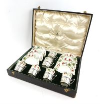 George V Aynsley coffee set with six coffee cups in silver holders, London 1912, and saucers,