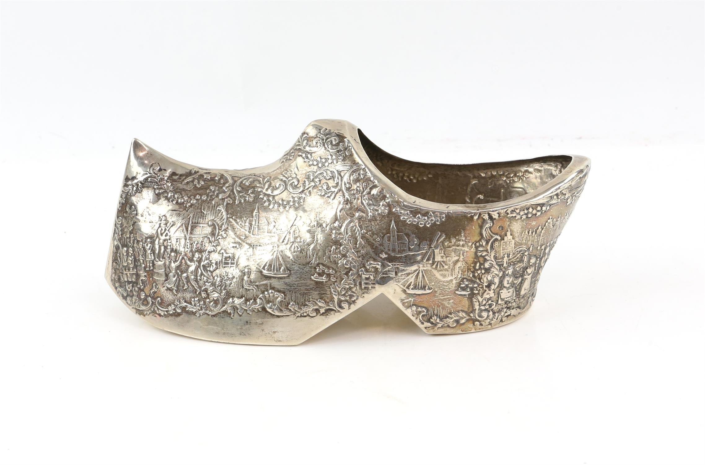 Large Dutch silver novelty model of a Clog embossed with Dutch scenes. marked for 835, 6.
