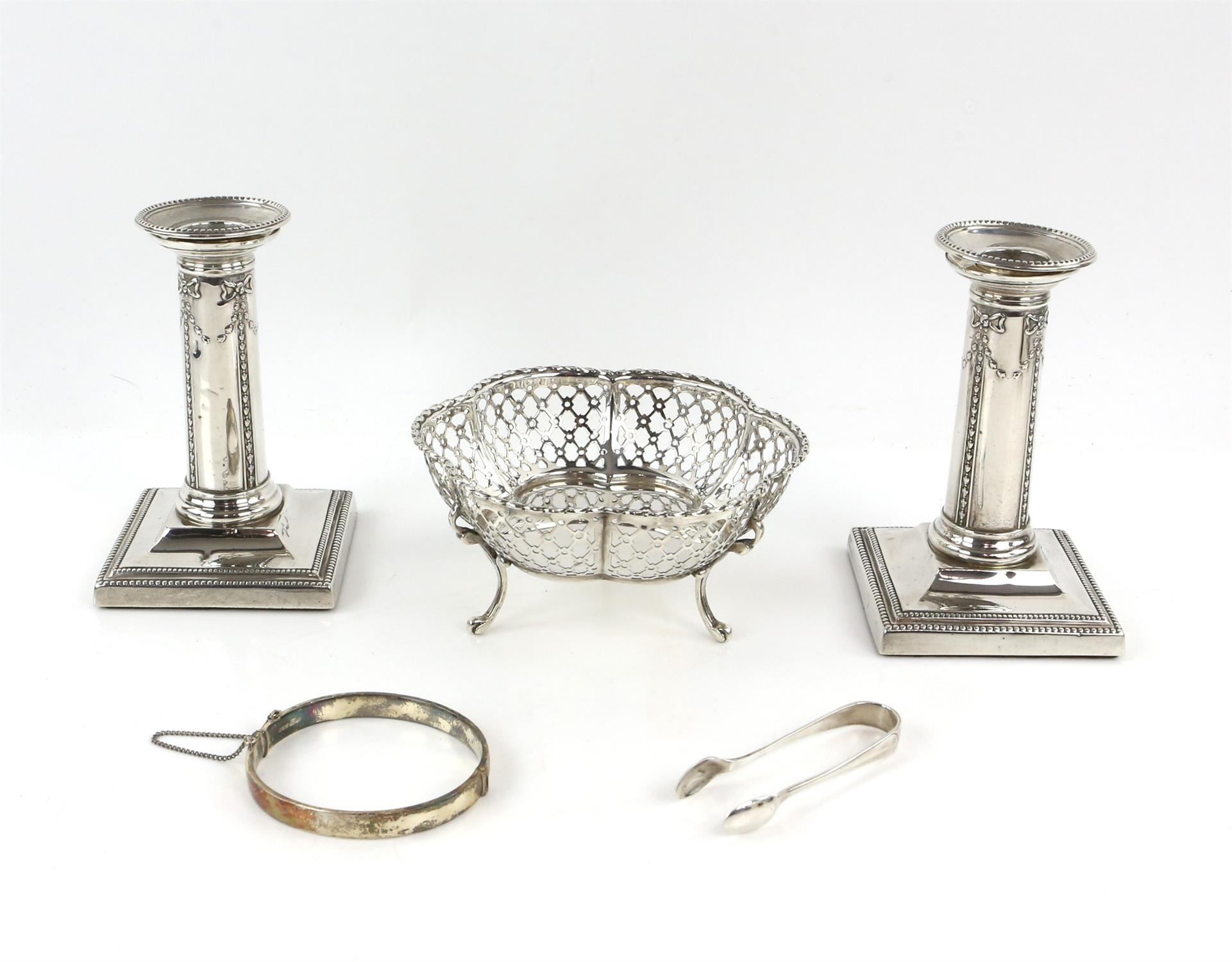 Pair of Victorian silver candlesticks with ribbon and swag decoration by Thomas Bradbury & Sons