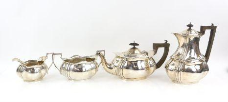 Edward VII silver four piece tea service, comprising teapot, hot water jug, cream jug and sugar