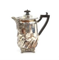 Victorian silver jug with half spiral fluted and reeded decoration on four lion mask and paw feet