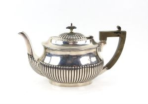 Edward VII half reeded silver teapot with ebonised handle and knob, London 1905, gross weight 569