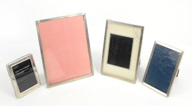 Three matched graduated silver photograph frames with engine turned decoration, by Sanders &