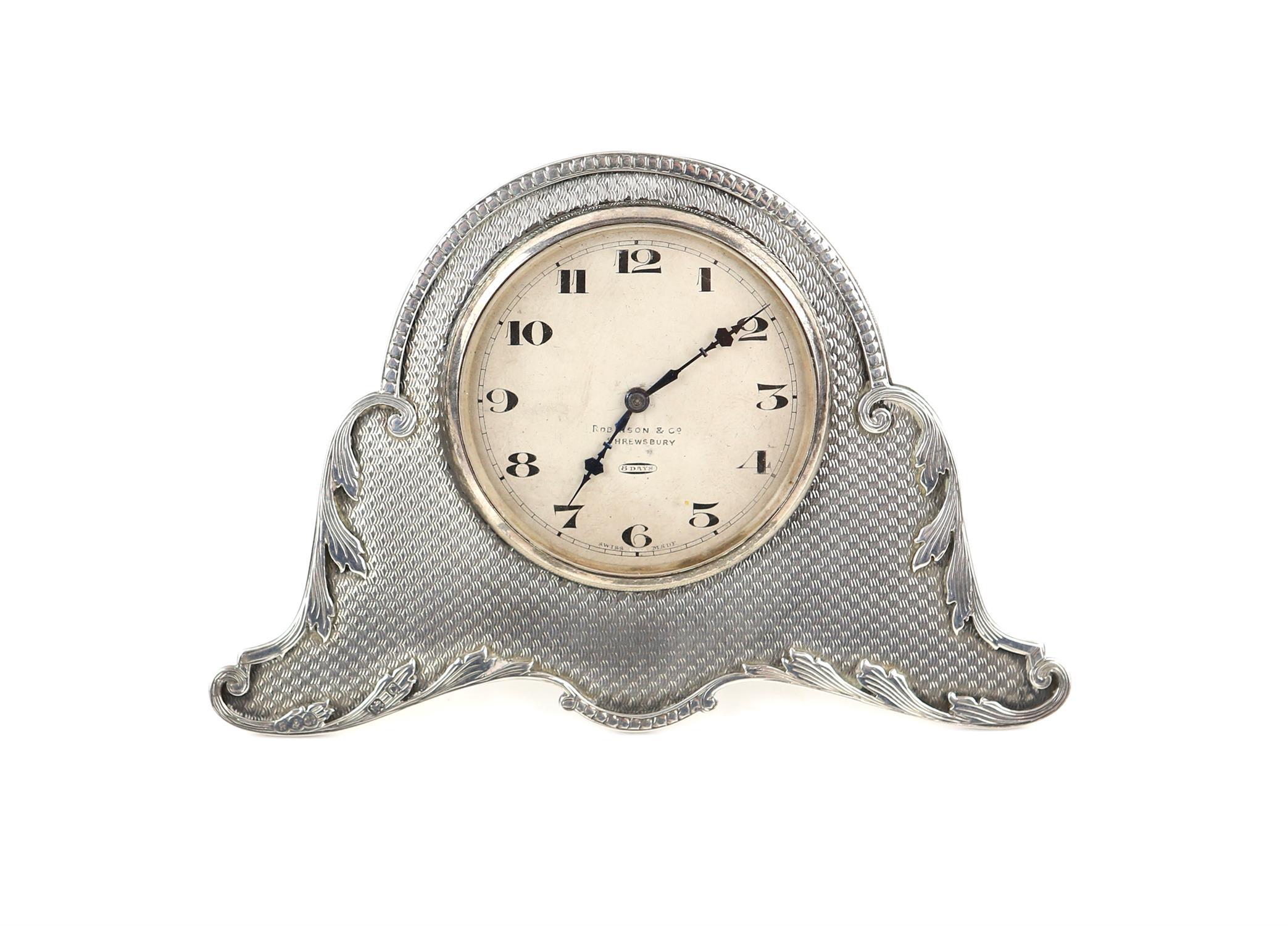 George V engine turned silver strut clock by Robinson & Co.Ltd, Birmingham 1927 H 8cm Sold on