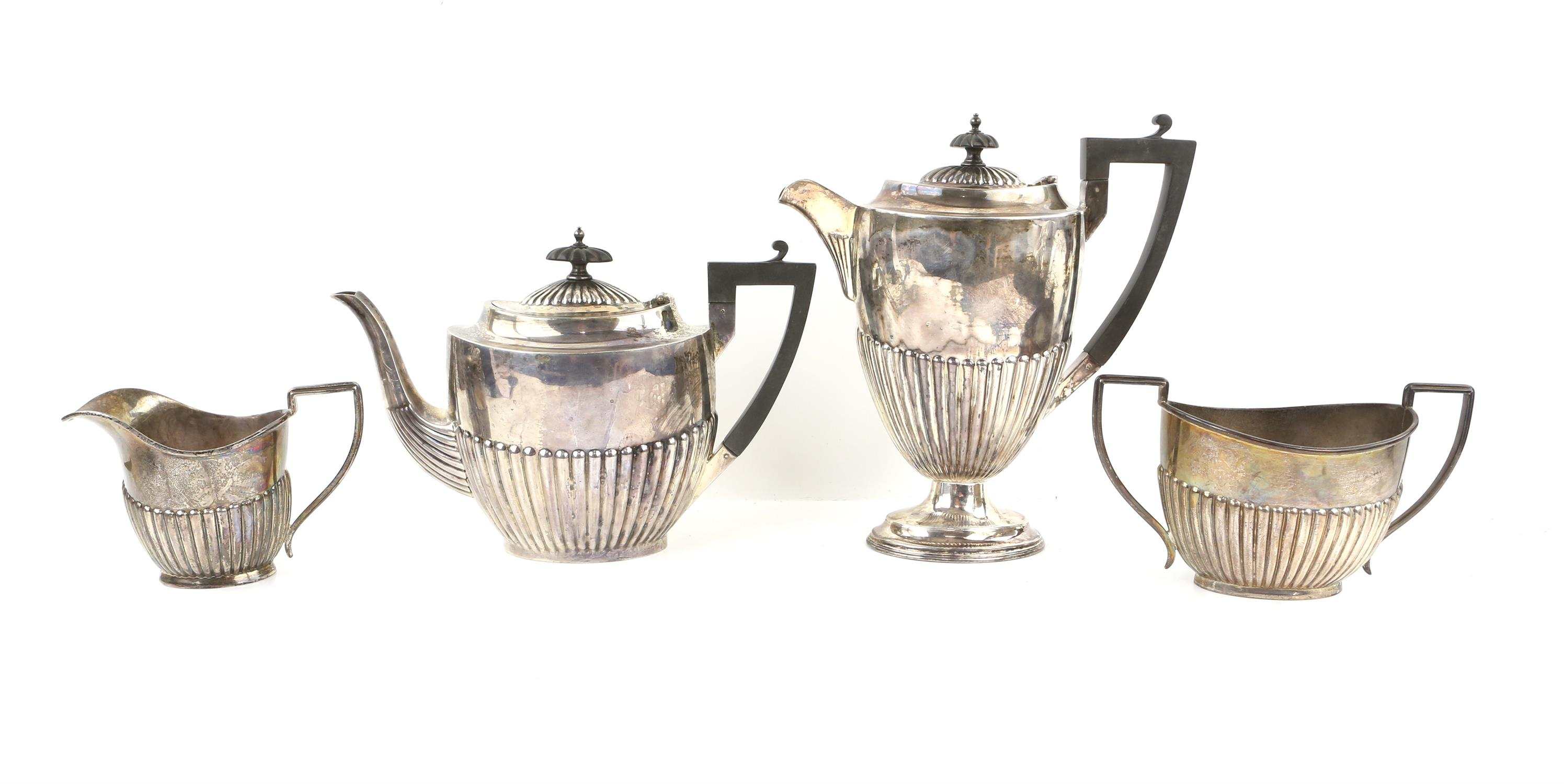 George V half reeded silver four piece tea and coffee service comprising teapot, coffee pot,