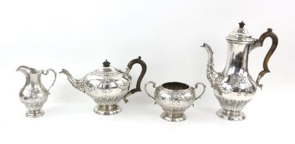 Victorian silver tea and coffee service with blank cartouches hung from ribbons and swags,