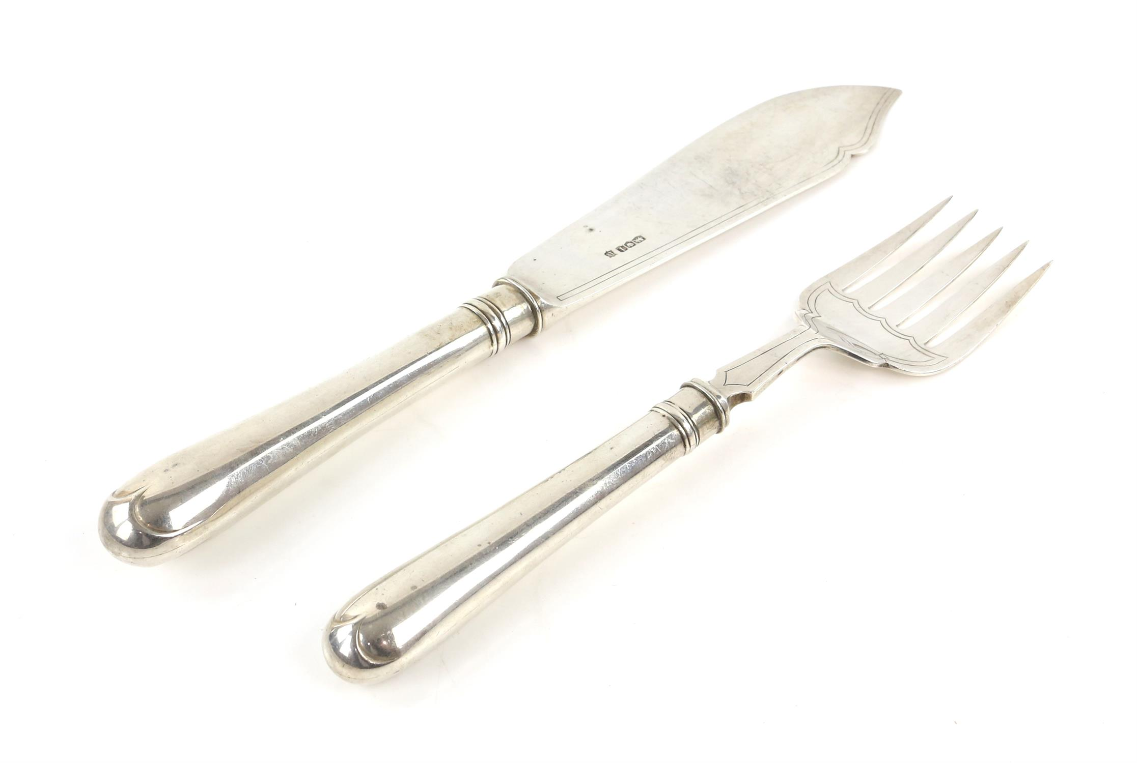 Two silver fish servers, including a knife and fork, Thomas Bradbury & Sons, Sheffield 1928,