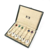 """A set of six silver coffee spoons by Liberty & Co with semi precious stone """"bean"""" terminals,"""
