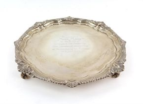 Silver presentation salver by Goldsmiths and Silversmiths company, with shell and foliate scroll