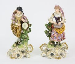 A pair of early 19th century Derby figures as male and female Musicians, brightly decorated in