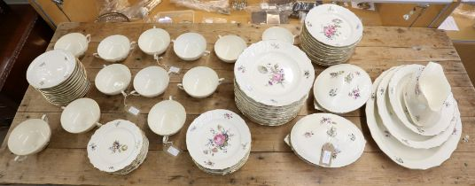 Extensive Royal Copenhagen dinner service with blind lattice border and floral decoration,