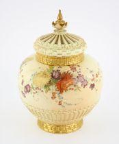 Royal Worcester pot pourri vase and cover, with floral decoration on basket weave design base,