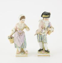 Pair of 19th century Berlin porcelain figures of a young man and woman with a basket of flowers,