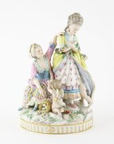 AMENDED DESCRIPTION Late 19th century Dresden figural group of two women with Eros and a putto,